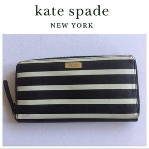 KATE SPADE BLACK AND WHITE STRIPE ZIP AROUND WALLET